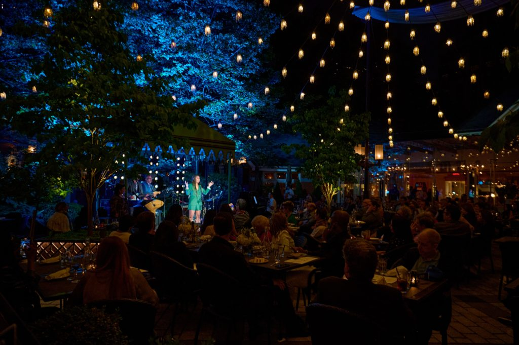 Dining under the stars, enjoying Broadway performers!